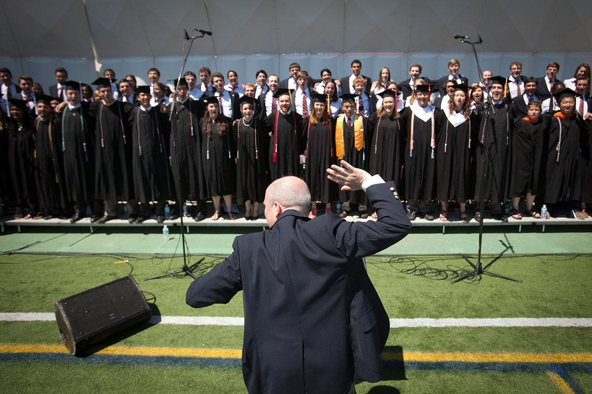 Robert Isaacs conducts the Cornell Chorus at the 2014 Commencement Ceremony.