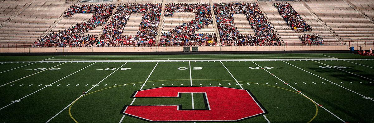 "Students forming ""2020!"" in the stands of Schoellkopf Field."
