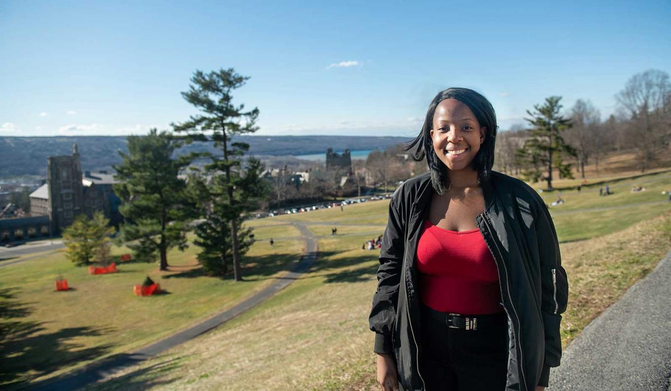 Grace on Libe Slope with a view of the lake beyond