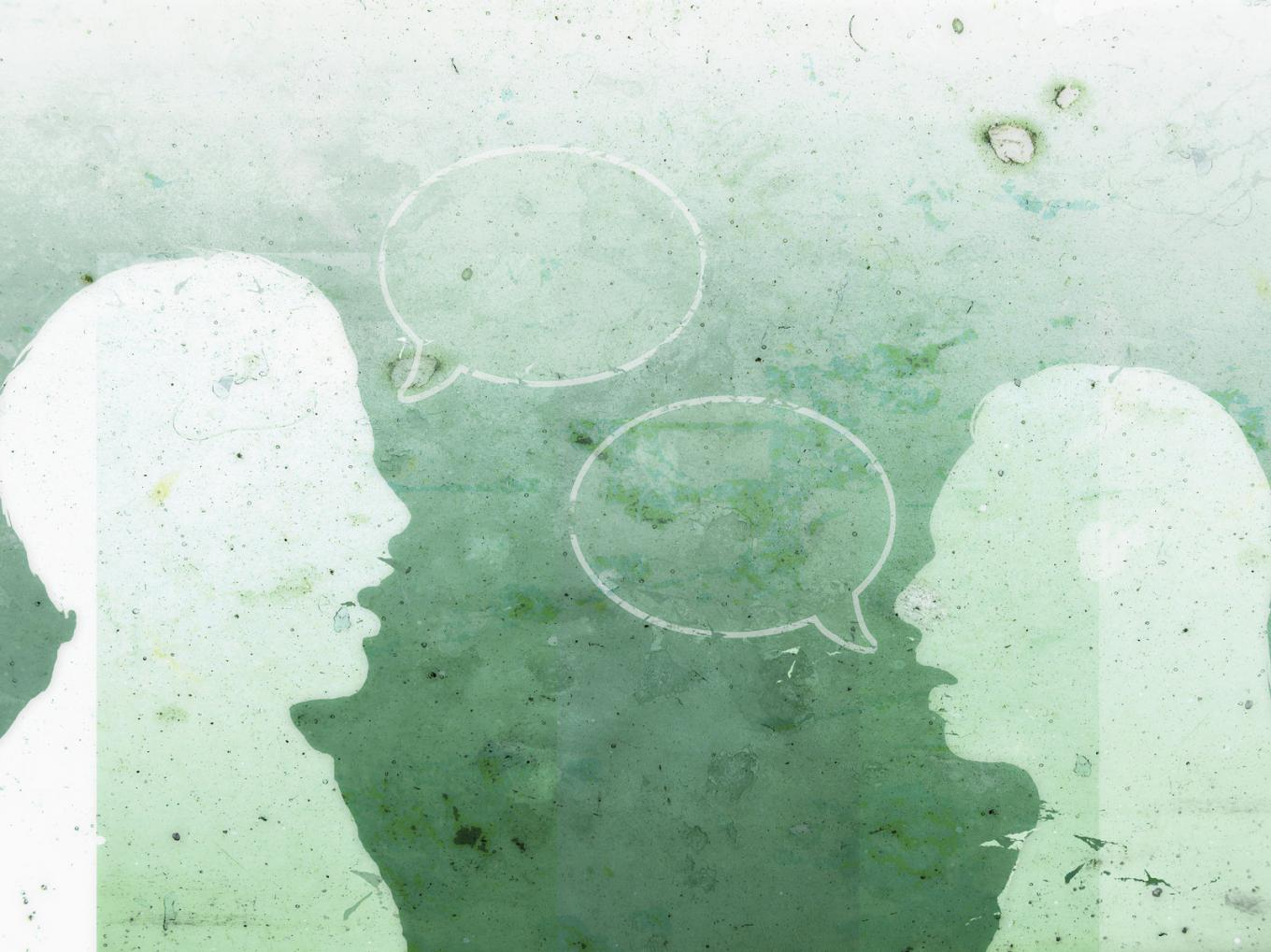 Silhouettes of two people in conversation, with empty speech bubbles floating between them
