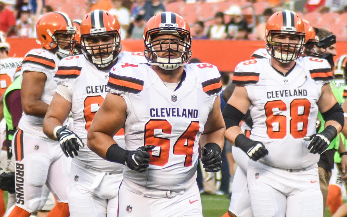 JC Tretter (#64) leads the Cleveland Browns' offensive line onto the field (Erik Drost).
