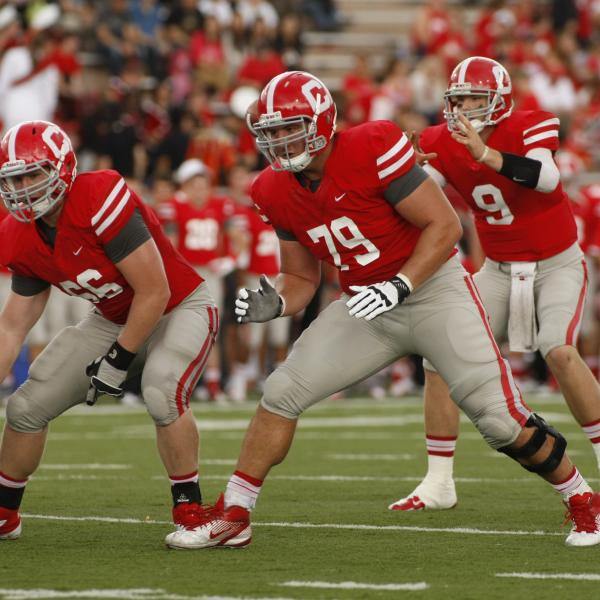 JC Tretter (#79) on the offensive line protecting Jeff Mathews' (#9) blindside in a game vs. Yale in 2012 at Schoellkopf Field (Tim McKinney).
