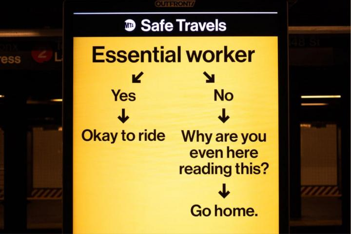 MTA subway sign telling non-essential workers to go home