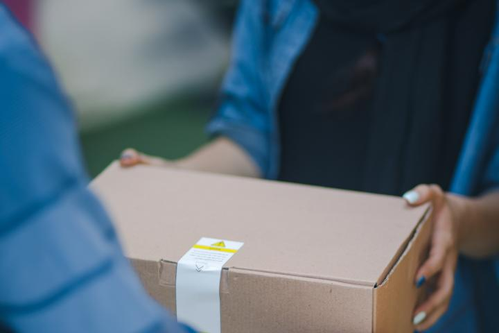 photo of a box being delivered to illustrate frontline workers
