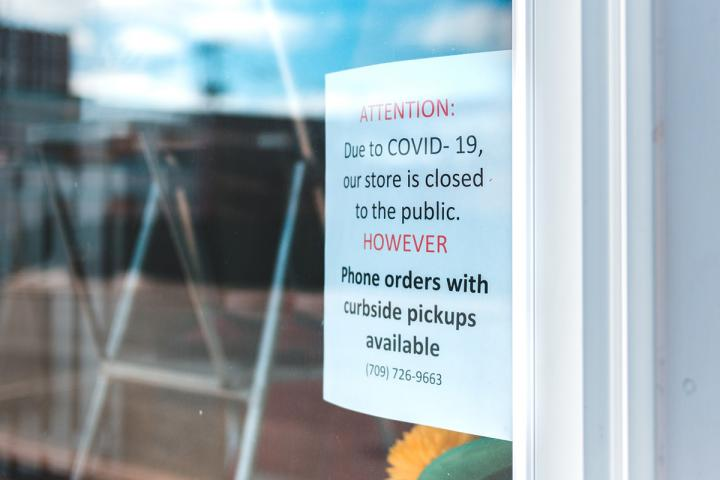 Sign on store door stating that they are closed but pickups can be scheduled.