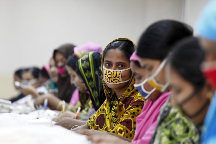 Female garment workers wearing masks.