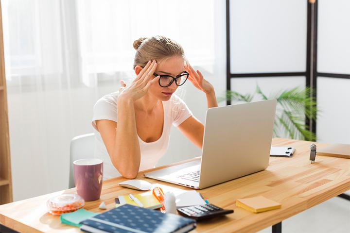 Woman working from home showing frustration
