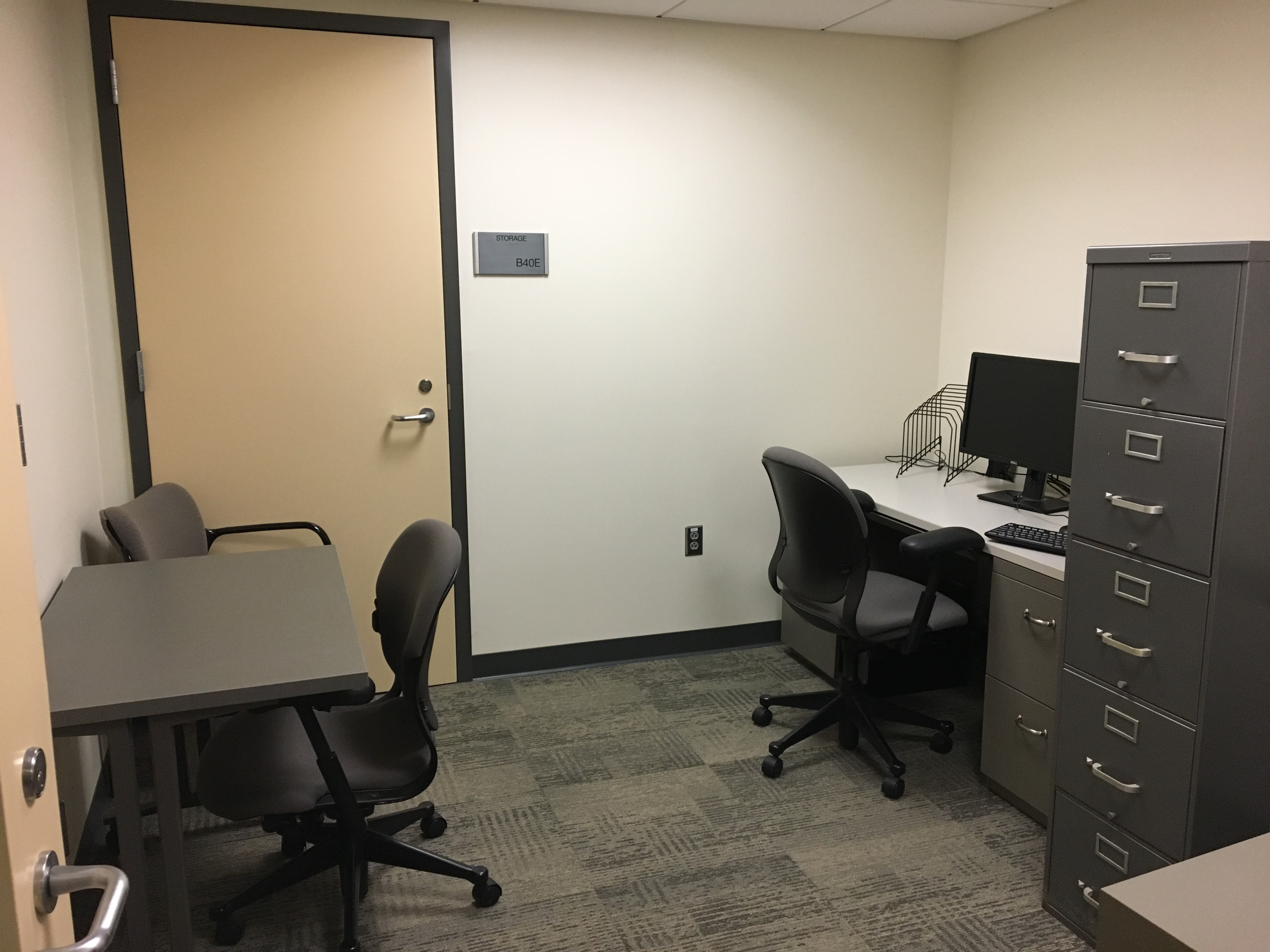 Room with two desks against opposite walls