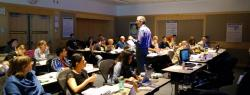 Instructor teaches room full of participants