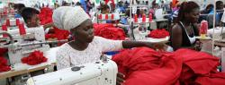 Photograph of Dignity factory workers producing shirts for overseas clients, in Accra, Ghana