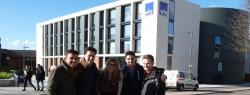 Students in front of University of Warwick building