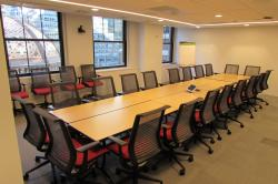 NYC conference center meeting room B with chairs around the table