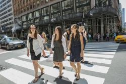 ILR student interns cross a street in NYC