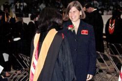 Laura Lewis congratulates a recent graduate.