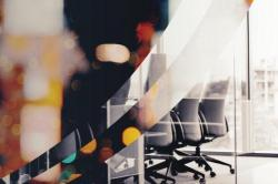 Abstract image of chairs in a boardroom
