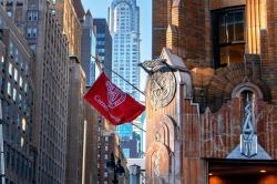 Cornell flag flying from a pole outside 570 Lexington Ave, NY, NY