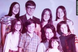 Aging photo from the 70s of a family of 9