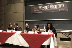 Panelists sit at table in front of banner reading, The Worker Institute, advancing worker rights and collective representation