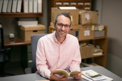Eli Freidman working in ILR's Kheel Center.