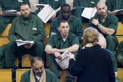 Inmates at Cayuga Correctional facility listen with great focus to Esta Bigler speak about their rights