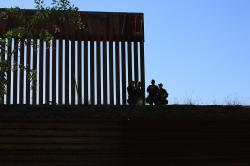 Border fence between the USA and Mexico including New Construction adding an additional layer of fencing and razor wire or barbed wire to secure the border.