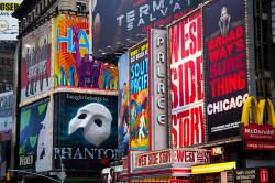 Shot of Broadway theater marquees - Phatom of the Opera, West Side Story, etc.
