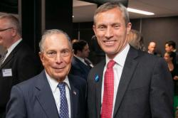 Dean Alex Colvin and former New York City mayor Mike Bloomberg