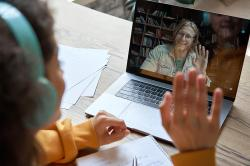 A student participates in an online class