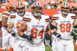 JC Tretter running on to the football field with Cleveland Brown teammates.