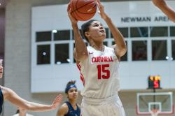 Theresa Grace Mbanefo shoots the ball over a defender during the Cornell Big Red women's basketball team's contest against Duquesne on Tuesday, Dec. 10, 2019 in Newman Arena in Ithaca, NY. (Eldon Lindsay/Cornell Athletics)