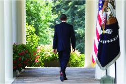 President Obama walking away from camera and into the Rose Garden
