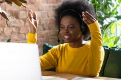 A young black women works remotely.