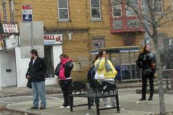 People waiting at a bus stop in Buffalo, NY