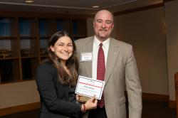 Emily Abelow receives the John O'Donnell Prize in Labor Law from Kevin Harris, the Frank B. Miller Director of ILR Student Services.