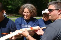 Union Leadership Institute paricipants hold sections of pipe at retreat