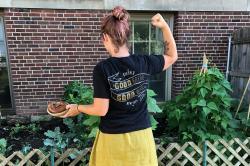 "Person wearing a ""good bread, good work"" t-shirt"