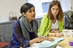 Women speaking in class