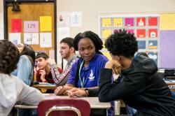 Students sit with ranging levels of attention in a public school classroom
