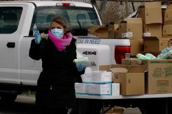 Mask distribution by Eight Days of Hope in Buffalo, NY