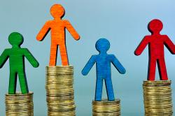 Pay equality for equal work concept. Figures and coins.