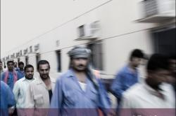 Blurred image of many men in the street