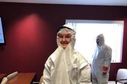 This photo shows the proper personal protective equipment, minus the mask, that one would wear during lead safe work on home RRP projects under EPA guidelines.