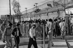 June 17, 1954: In Southern California, Mexican migrants enter El Centro border patrol compound prior to deportation. (Larry Sharkey / Los Angeles Times Archive / UCLA)