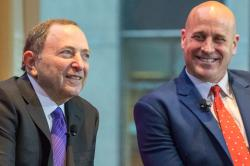 Gary Bettman, left, and Mike Levine spoke at the summit.