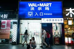 A Walmart store in Shenzhen, China, where the company opened its first store in the country two decades ago. Some of Walmart's workers in Shenzhen recently filed a lawsuit demanding back pay. Lam Yik Fei for The New York Times