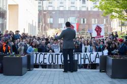 """Mayor Svante Myrick speaks at rally for José Guzman-Lopez, who was remanded to U.S. Marshals' custody on Friday. Hundreds protested his arrest by ICE agents earlier this month in Ithaca. Protestors hold banner reading """"ICE OUT OF ITHACA"""" [Cameron Pollack]"""